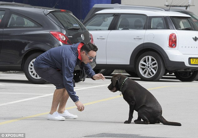 Pet owner: The funnyman appeared to be spending some alone time with his pooch