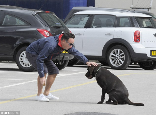 Not so mean: Ant patted his pet dog after their training session