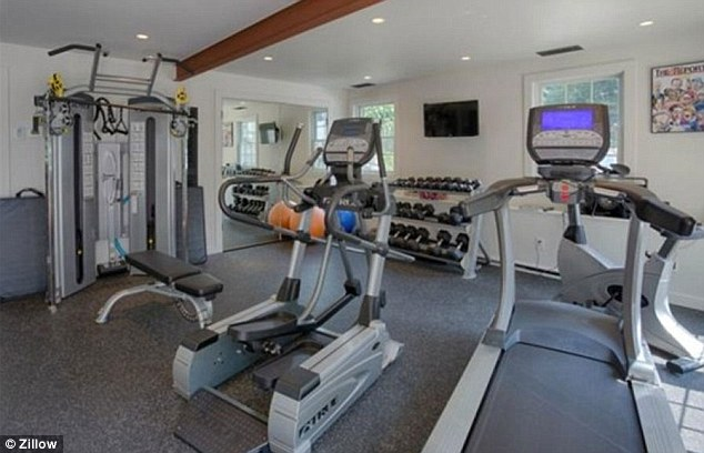 Working up a sweat: The inside of the home features many luxuries including a gym with plenty of workout equipment