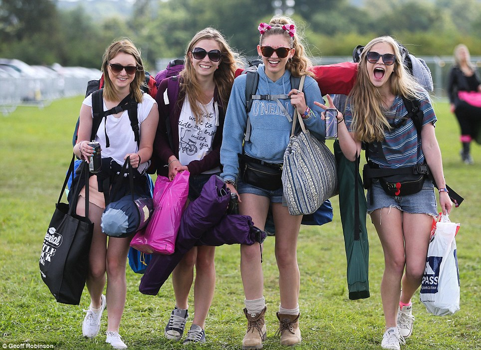 Entrance: Music fans arrived at Hylands Park in Chelmsford, Essex, ahead of this weekend's V Festival - without their wellington boots