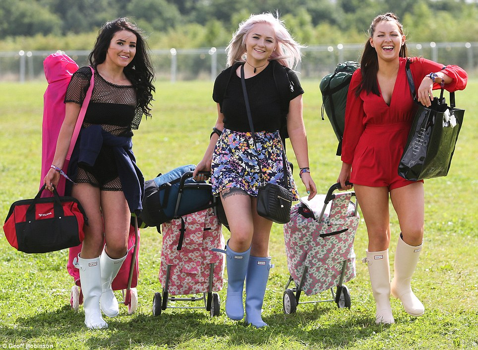 Attire: Three revellers arrive at the festival wearing shorts, but have their wellington boots on ready for the showers that are expected throughout the weekend