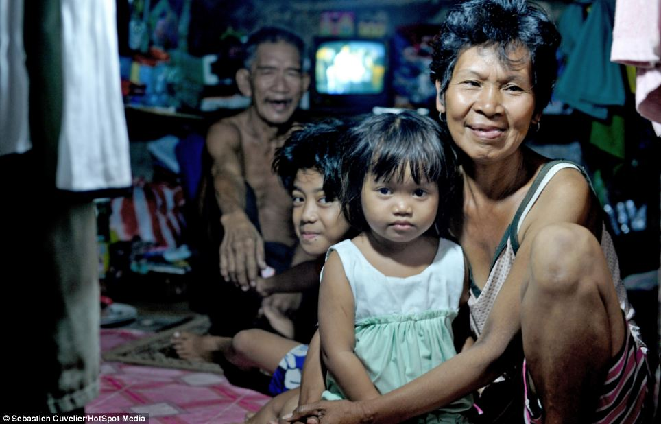 With poverty widespread many people live in makeshift homes. This family live in a cramped room built under a canal bridge in Quiapo, Manila
