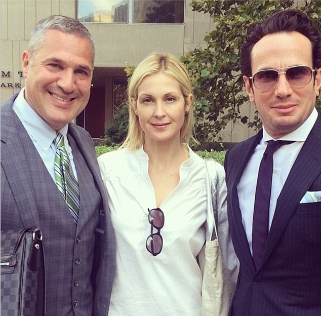 'Blessed to have such an amazing team': Kelly Rutherford posted a picture of herself with lawyers Michael Wildes, on the left, and Robert Wallack on the right after her court appearance in New York on Wednesday