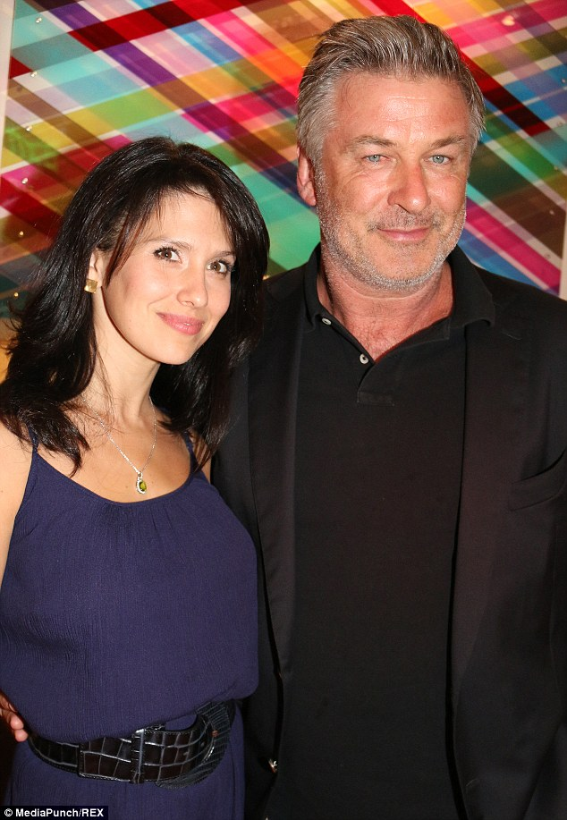 Head over heels: The brunette was picking clothes to go on a date with husband Alec Baldwin, picture in July