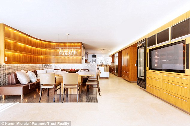 All the mod cons: The home features a menagerie of televisions and an electronically moveable dining table