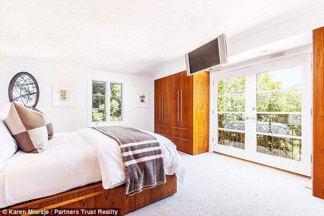Master bedroom: Kimmel's bedroom features plenty of light from the multitude of windows although the white carpet may deter a family from moving in