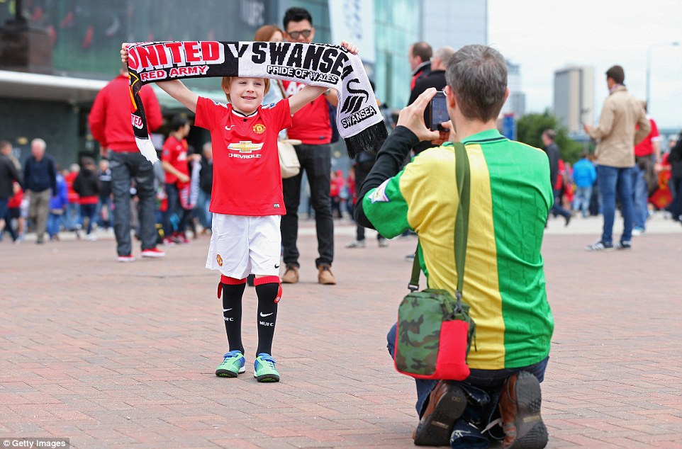 A new era: Excitement builds before the game as supporters start arriving for the first match of Dutch manager Van Gaal's reign