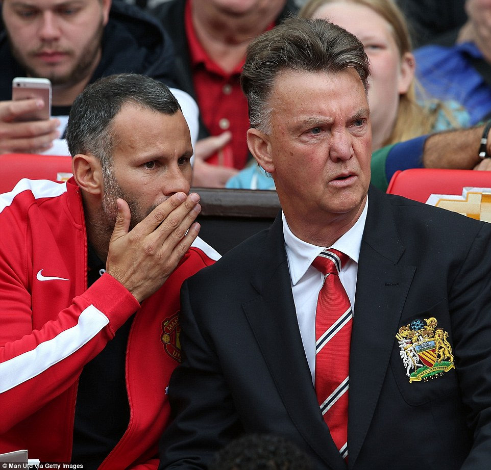 Not going to plan: Assistant manager Ryan Giggs and gaffer Van Gaal talk tactics in the first half, which saw Swansea take a deserved 1-0 lead at Old Trafford