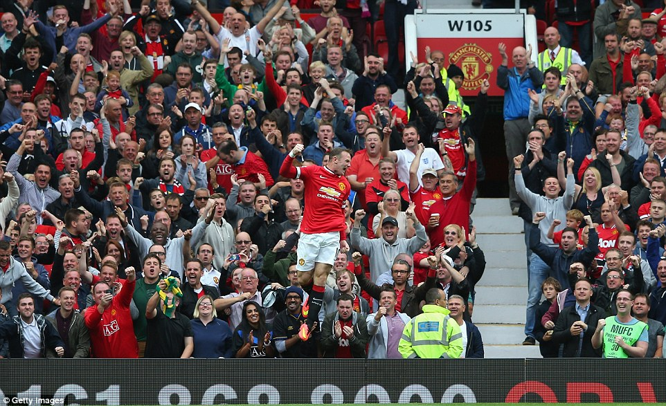 Captain fantastic: Rooney celebrates in front of the United fans after scoring against Swansea to cancel out Ki's first-half strike
