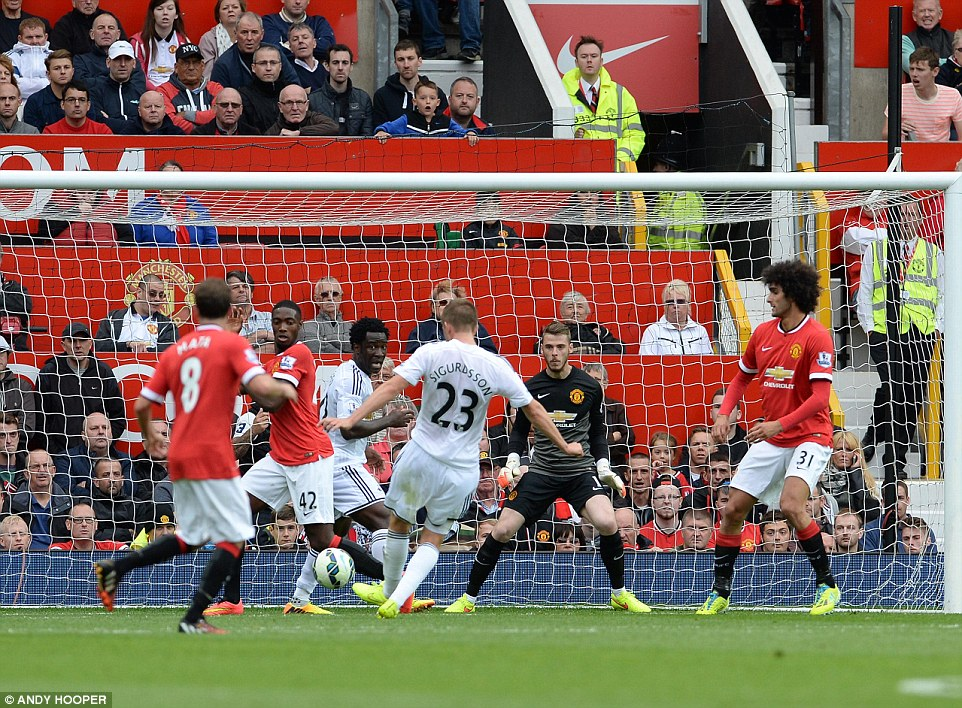 Restoring the advantage: Gylfi Sigurdsson puts Swansea back in front with a close-range strike in the
