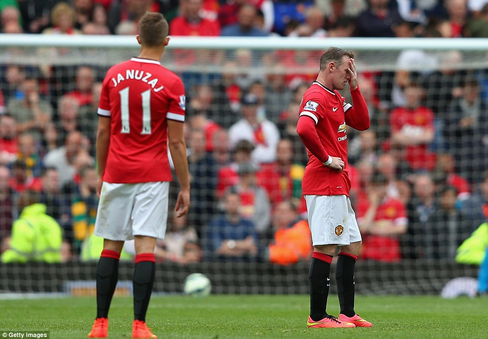 Please, not again: Wayne Rooney can barely believe it as Swansea record a 2-1 win at Old Trafford for the second consecutive season
