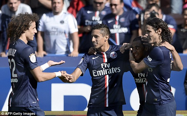 Strong display: Luiz celebrates with fellow PSG stars Marquinhos, Lucas and Edinson Cavani