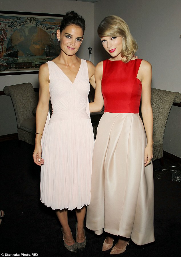 Pretty in pink: Katie posed with The Giver co-star Taylor Swift during the film's premiere in NYC earlier this week