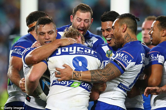 The Bulldogs celebrate after Aiden Tolman scored a try on Friday night against the Eels