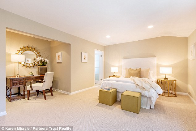 Shades of cream: Much of the plush pad features wooden floors, and neutral paint tones with floor to ceiling windows
