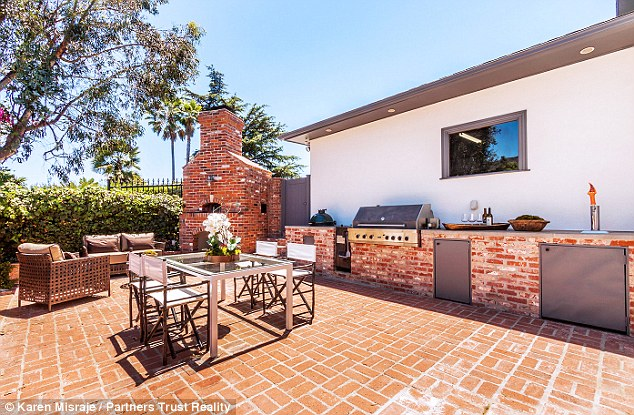 Keen chef: The outdoor kitchen features a pizza oven, barbecue and smoker