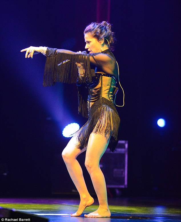 Bare feet: Fans flew in from as far as Kuwait to see Tina Arena's Reset tour  in Perth as she kicked off her shoes and pranced around the stage in a sexy sheer dress