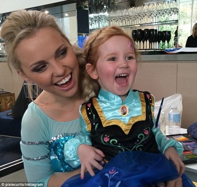 Regal: A friend dressed as her Frozen sister Princess Elsa joins in the fun