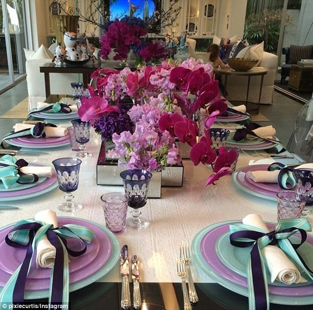 Sweet and sophisticated: The table decorations were certainly second to none, with a dazzling blue, purple and pink colour scheme to complement the Frozen theme