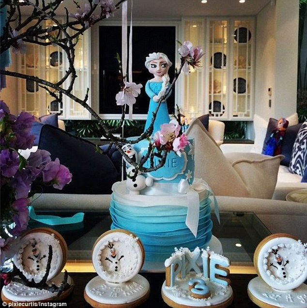 What a treat: Pixie was surprised with a delectable Frozen themed red velvet cake