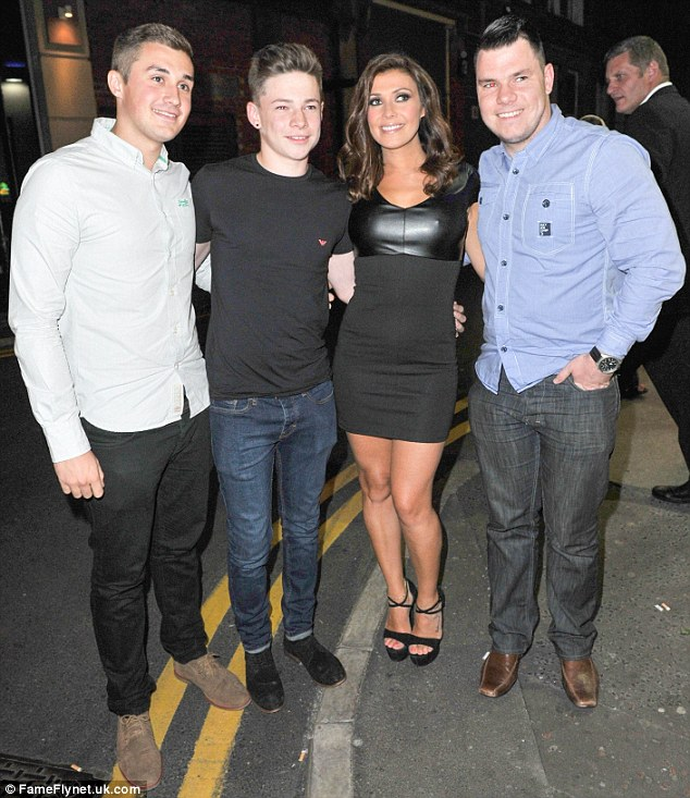 Cheese: Kym proved popular as she left the venue and posed for pictures with a group of lads