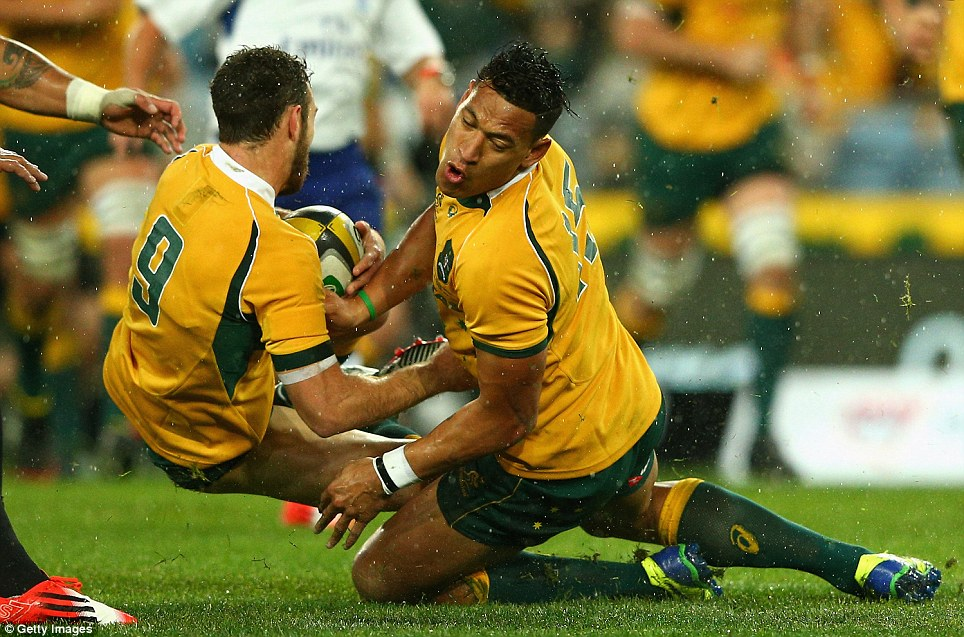 The moment Wallaby Israel Folau runs into his teammate Nic White and walks away second best during the first game of the Bledisloe Cup