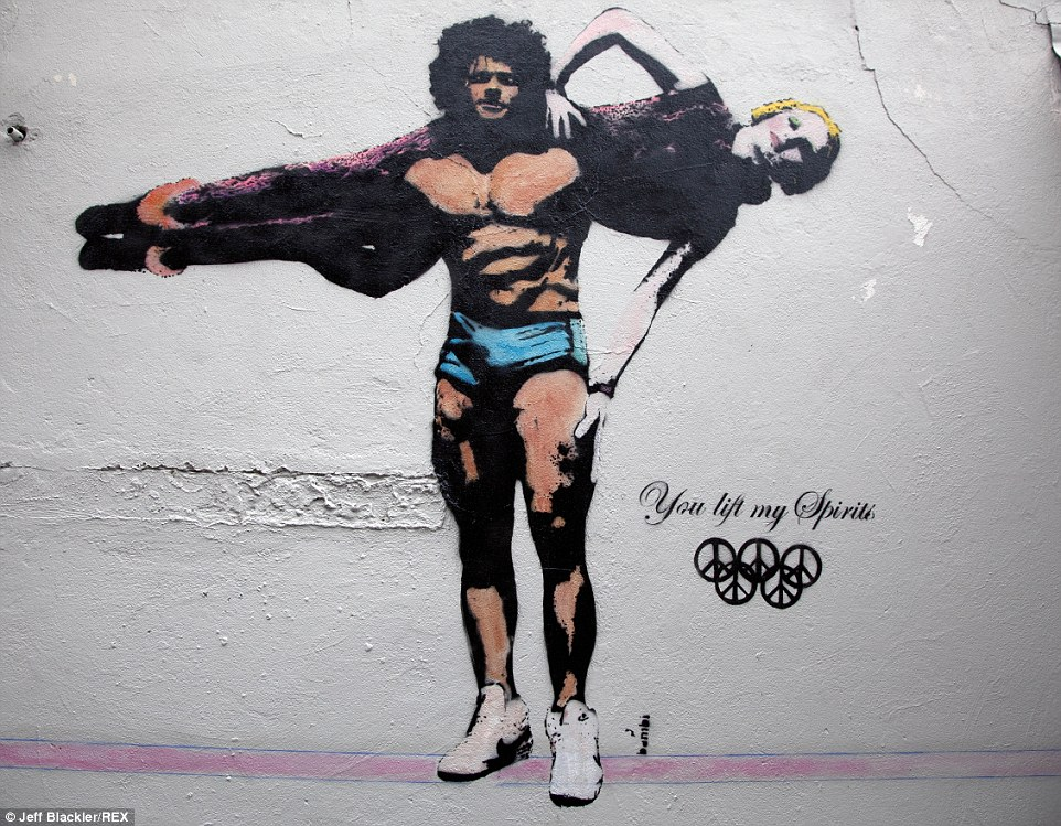 'You lift my spirits': This graffiti by  Bambi was seen on a wall in Islington, London. Stars including Kanye West, Brad Pitt and Rihanna are queuing up to buy her work since she caught the public eye in 2011 with a striking image of Amy Winhouse on a door in Camden