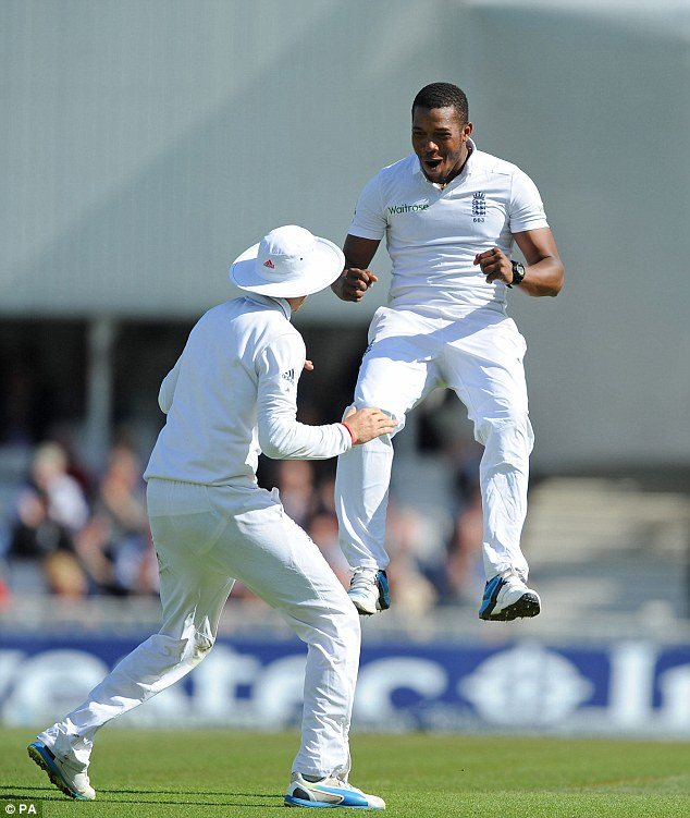 Jumping for joy: Chris Jordan celebrates with Joe Root after claiming the wicket of Virat Kohli for 20