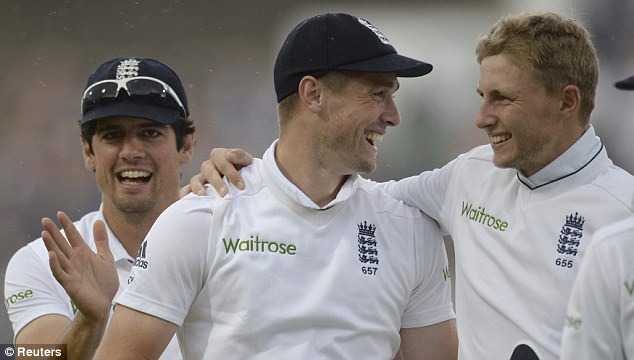 Deadly throw: Chris Woakes gets a pat on the back from Joe Root and captain Alastair Cook after running out India's Gautam Gambhir for just three runs
