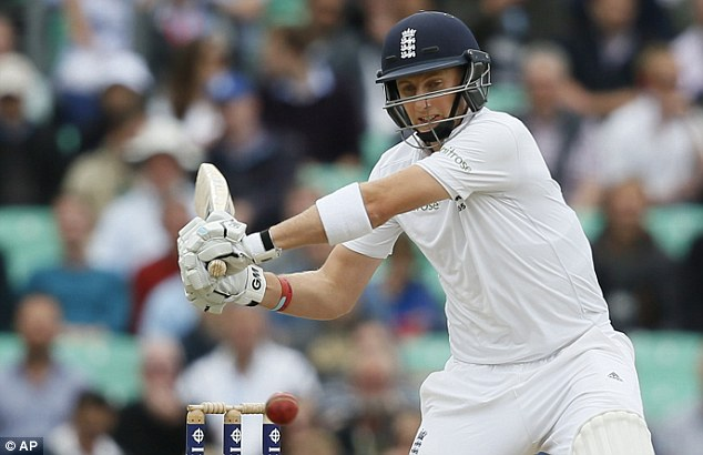 Timing: Root watches the ball intently before hitting Ishant Sharma to the boundary for four