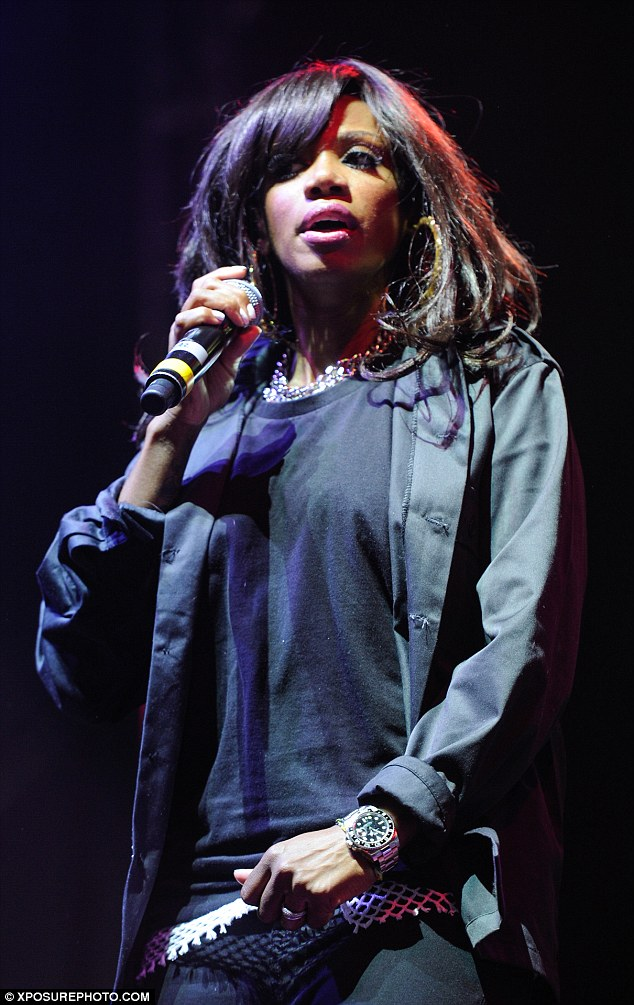 She a saint! Singer Shaznay Lewis looked cool in an unbuttoned black shirt