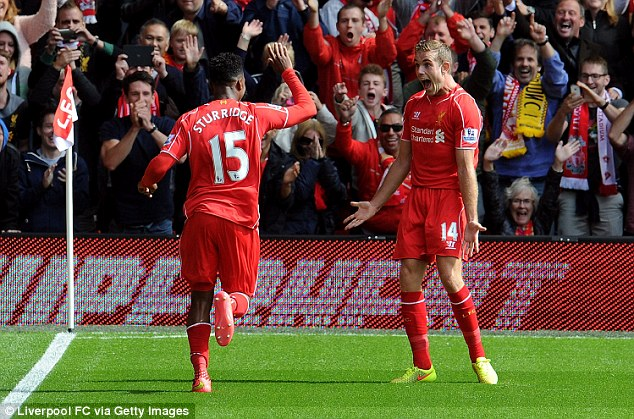 Happy days: Lovren's side claimed all three points thanks to goals from Daniel Sturridge and Raheem Sterling