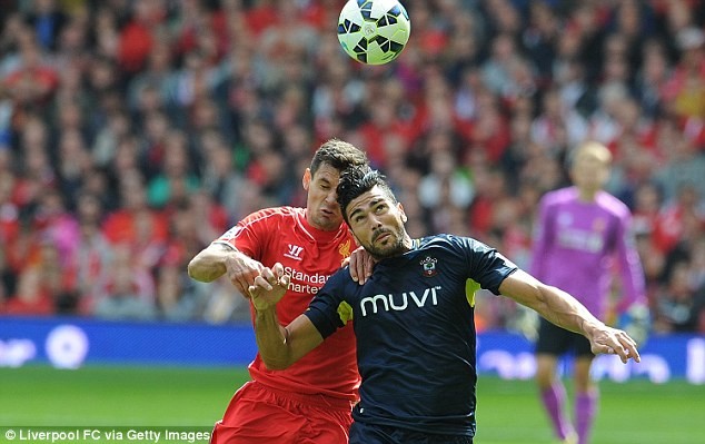 Jumping for joy: Lovren battles Southampton new boy Graziano Pelle for the ball during Sunday's league clash