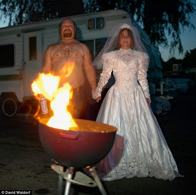 Touching: Waldorf took the photo of the woman in the dress after learning it was one of her only possessions. Divorced by the time the photo was taken, her brother stood in as a shirtless, barbecuing bridegroom
