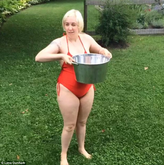 I'm in! Lena Dunham donned an orange swimsuit to participate in the ALS Ice Bucket Challenge for charity, dumping a bucket of cold water over her head on Saturday