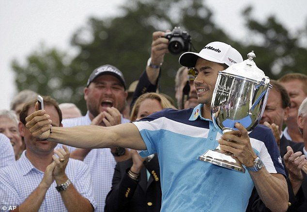 Always time for a selfie: Villegas poses with the trophy after being crowned champion in Greensboro