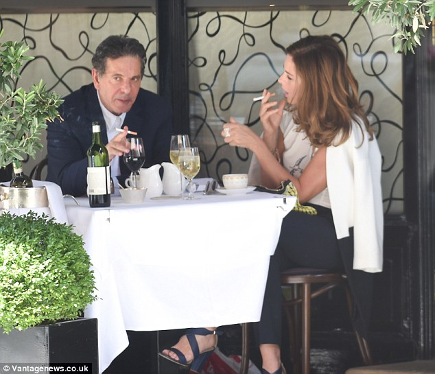 Distracted: It appeared as though something else had caught Charles' attention while his date Trinny tried to make eye contact