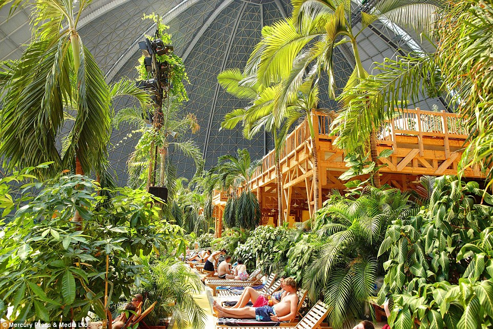 Soaking up the artificial rays: Tropical Islands has only 400 sunloungers to accommodate 6,000 visitors