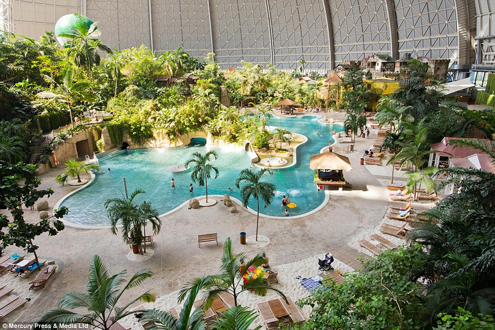 Sunny all year round: Inside, the hangar is home to pools, beaches, balmy lagoons and the world's largest indoor rainforest