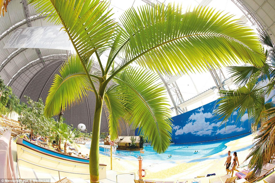 Don't look up: Holidaymakers can pretend they are lounging on a tropical island, as long as they ignore the ugly grey dome above