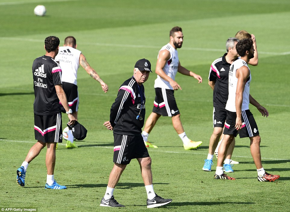 Prowler: Boss Carlo Ancelotti watches on during the session on Monday