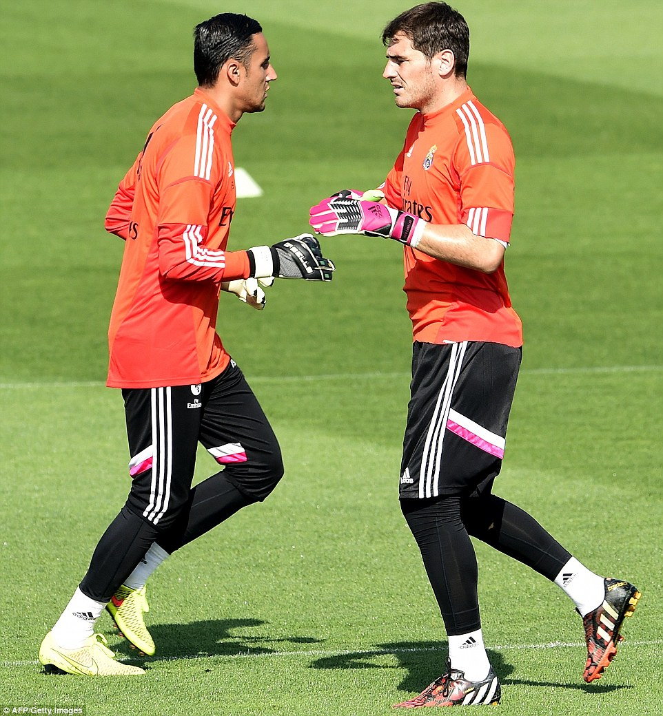 Face off: Navas had a superb World Cup with Costa Rica whilst Casillas had a slightly more disappointing tournament with Spain