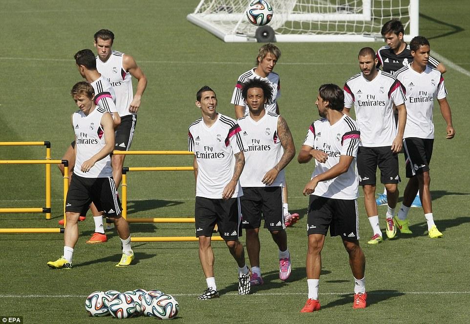 The whole gang: (L-R) Luka Modric, Ronaldo, Bale, Angel di Maria, Marcelo, Coentraeo, Khedira, Benzema and Raphael Varane all in training