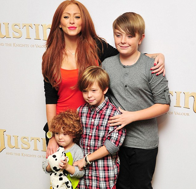The star, pictured here with her three sons (pictured from left to right: Alfie, Harry and Josh claims to have suffered from severe Post Natal Depression in a previous pregnancy