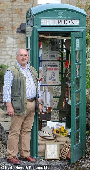 Small project: John Hay, 67, has decked out the former British Telecom box with First World War memorabilia in Barningham, County Durham