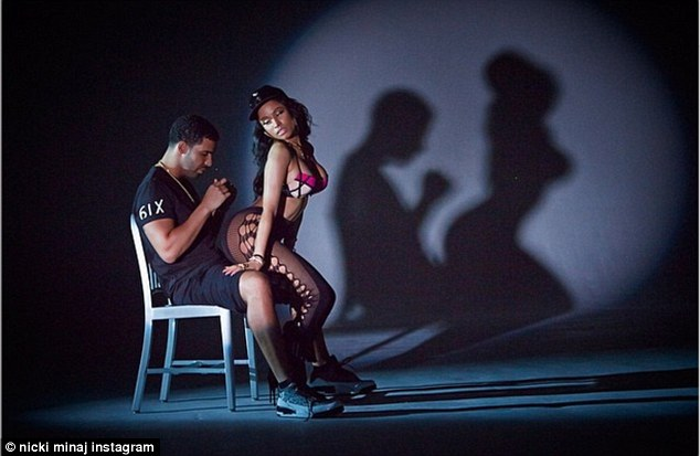 Getting into it: She gyrates her derriere in his lap, creating a shadow of the pair on the wall, and is clearly rather proud of the effect, captioning the snap, 'that silhouette tho...'