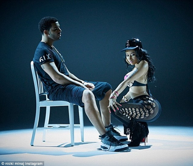 Saucy: Nicki Minaj gives Drake a lap dance in a still from her upcoming music video for Anaconda