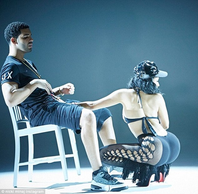 X-rated: Nicki shows off her famous derriere as she places her hand just above Drake's crotch