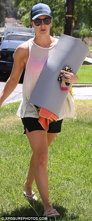Lover: The short-haired star sported a shirt that read 'friends' and a hot pink sports bra
