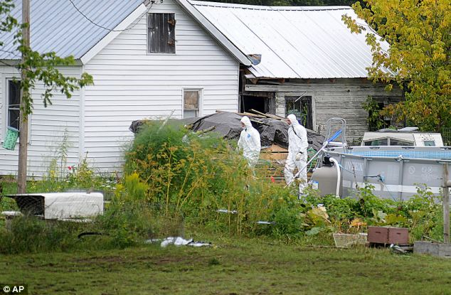 Search: On Sunday, investigators continued to collect evidence from their home in Hermon, New York